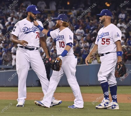 Stock Picture of Los Angeles Dodgers' Justin Turner (10) playfully yanks the beard of closing pitcher Kenley Jansen (74) as Albert Pujols (55) looks on after the Dodgers beat the Colorado Rockies 1-0 at Dodger Stadium in Los Angeles on Saturday, July 24, 2021.