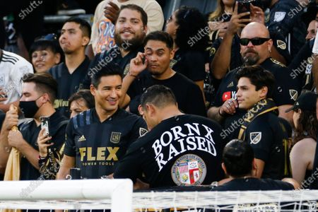 Stock Image of Ryan Garcia, right, and Mario Lopez attend an MLS soccer match between the Los Angeles FC and the Vancouver Whitecaps in Los Angeles