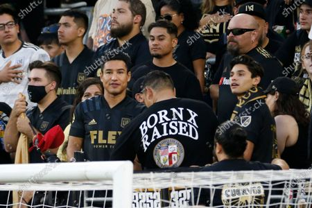 Ryan Garcia, right, and Mario Lopez attend an MLS soccer match between the Los Angeles FC and the Vancouver Whitecaps in Los Angeles