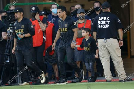 Mario Lopez and his son attend an MLS soccer match between the Los Angeles FC and the Vancouver Whitecaps in Los Angeles
