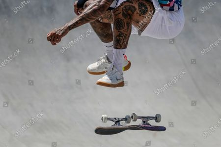 Nyjah Huston of the United States performs a trick in the men's street skateboarding at the 2020 Summer Olympics, in Tokyo, Japan
