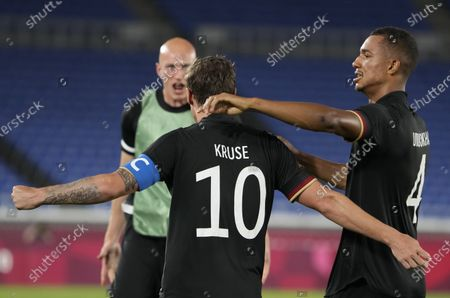 Germany's Felix Uduokhai, right, celebrates with teammate Max Kruse after scoring during a men's soccer match against Saudi Arabia at the 2020 Summer Olympics, in Yokohama, Japan