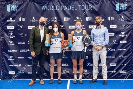 Stock Image of Paddle tennis players Ariana Sanchez (2R) and Paula Josemaria (2L) attend the trophy ceremony after they defeated Marta Ortega (unseen) and Marta Marrero (unseen) at women's Estrella Damm Las Rozas Open 2021's final game in Las Rozas, Madrid, Spain, 25 July 2021.