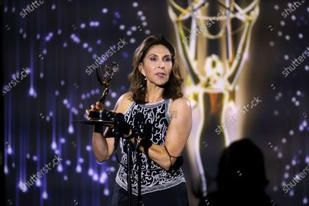 Stock Picture of Miriam Hernandez accepts the Crime/Social Issues News Story Emmy for ABC7's 'Gabriel Fernandez' during the 73rd Los Angeles Area Emmy Awards at the Television Academy Plaza in North Hollywood, Calif on