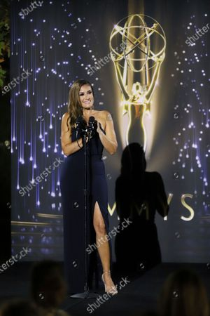 Stock Picture of Naibe Reynoso of LA County Channel 12 presents the Emmy to winners in several categories at the 73rd Los Angeles Area Emmy Awards, at the Television Academy Plaza on in North Hollywood, Calif