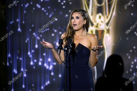 Naibe Reynoso of LA County Channel 12 presents the Emmy to winners in several categories at the 73rd Los Angeles Area Emmy Awards, at the Television Academy Plaza on in North Hollywood, Calif