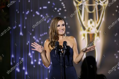 Stock Image of Naibe Reynoso of LA County Channel 12 presents the Emmy to winners in several categories at the 73rd Los Angeles Area Emmy Awards, at the Television Academy Plaza on in North Hollywood, Calif