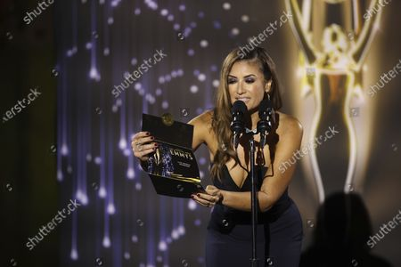 Naibe Reynoso of LA County Channel 12 announces the Sports Series - Programming Post-Produced) winner during the 73rd Los Angeles Area Emmy Awards held at the Television Academy Plaza in North Hollywood, Calif on