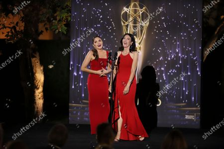 Gabriela Teissier and Yarel Ramos of Univsion/KMEX present the Emmy to winners in several categories at the 73rd Los Angeles Area Emmy Awards, at the Television Academy Plaza on in North Hollywood, Calif