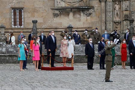 Spain's King Felipe (C-L) and Queen Letizia (C-R), Spain's Princess Leonor (2-L) and Infanta Sofia (L) attend the traditional Apostle Saint James floral offering at the Cathedral in Santiago de Compostela, Galicia, northern Spain, 25 July 2021. Galicia celebrates its regional day on 25 July, marking Saint James Day, the patron saint of both Spain and Galicia.