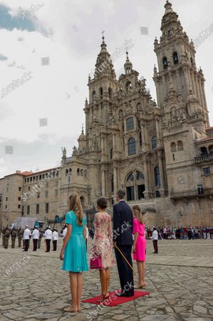 Spain's King Felipe (2-R) and Queen Letizia (2-L), Spain's Princess Leonor (R) and Infanta Sofia (L) attend the traditional Apostle Saint James floral offering at the Cathedral in Santiago de Compostela, Galicia, northern Spain, 25 July 2021. Galicia celebrates its regional day on 25 July, marking Saint James Day, the patron saint of both Spain and Galicia.