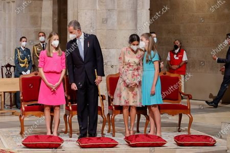 Stock Image of Spain's King Felipe (2-L) and Queen Letizia (2-R), Spain's Princess Leonor (L) and Infanta Sofia (R) attend the traditional Apostle Saint James floral offering at the Cathedral in Santiago de Compostela, Galicia, northern Spain, 25 July 2021. Galicia celebrates its regional day on 25 July, marking Saint James Day, the patron saint of both Spain and Galicia.