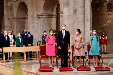 Spain's King Felipe (2-L) and Queen Letizia (2-R), Spain's Princess Leonor (L) and Infanta Sofia (R) attend the traditional Apostle Saint James floral offering at the Cathedral in Santiago de Compostela, Galicia, northern Spain, 25 July 2021. Galicia celebrates its regional day on 25 July, marking Saint James Day, the patron saint of both Spain and Galicia.