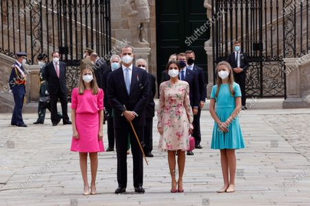 Stock Picture of Spain's King Felipe (2-L) and Queen Letizia (3-L), Spain's Princess Leonor (L) and Infanta Sofia (4-L) attend the traditional Apostle Saint James floral offering at the Cathedral in Santiago de Compostela, Galicia, northern Spain, 25 July 2021. Galicia celebrates its regional day on 25 July, marking Saint James Day, the patron saint of both Spain and Galicia.