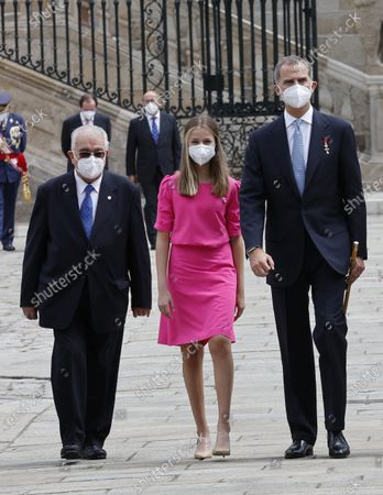 Spain's King Felipe (R), Spain's Princess Leonor (C) and President of the Spanish Constitutional Court Juan Jose Gonzalez Rivas (L) attend the traditional Apostle Saint James floral offering at the Cathedral in Santiago de Compostela, Galicia, northern Spain, 25 July 2021. Galicia celebrates its regional day on 25 July, marking Saint James Day, the patron saint of both Spain and Galicia.