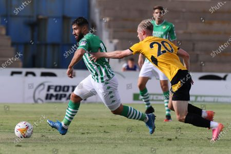 Nabil Fekir of Real Betis and Perry of Wolverhampton Wanderes FC during the pre-season friendly match between Real Betis and Wolverhampton at La Linea Stadium in La Linea, Spain, on July 24, 2021.
