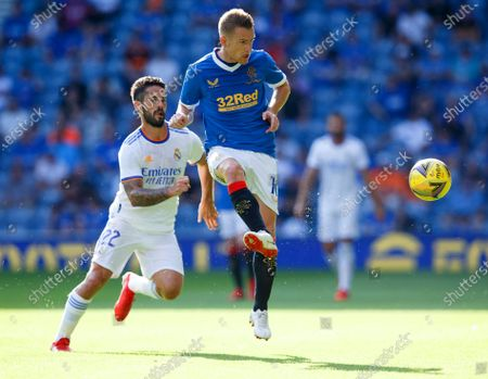 Isco (L) of Real Madrid in action against Steven Davis (R) of Rangers during the pre-season friendly test soccer match between Glasgow Rangers and Real Madrid at Ibrox Stadium in Glasgow, Britain, 25 July 2021.