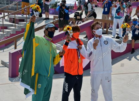 (L-R)Silver medalist Brazil's Kelvin Hoefler, old medalist Japan's Yuto Horigome and Bronze medalist Jagger Eaton of the United States pose for camera during the Tokyo Olympics Skateboarding Men's Street Medal Ceremony at Ariake Sports Park in Tokyo, Japan on Sunday, July 25, 2021.