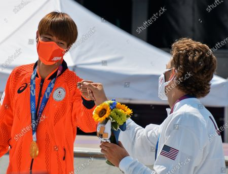 Gold medalist Japan's Yuto Horigome and .Bronze medalist Jagger Eaton, of the United States celebrate during the Tokyo Olympics Skateboarding Men's Street Medal Ceremony at Ariake Sports Park in Tokyo, Japan on Sunday, July 25, 2021.