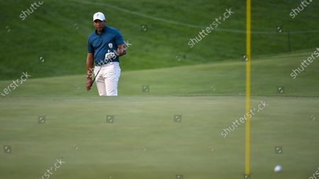 Jhonattan Vegas watches his shot on the the sixth hole during the third round of the 3M Open golf tournament in Blaine, Minn