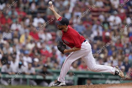 Boston Red Sox's Matt Barnes delivers a pitch against the New York Yankees in the ninth inning of a baseball game, in Boston