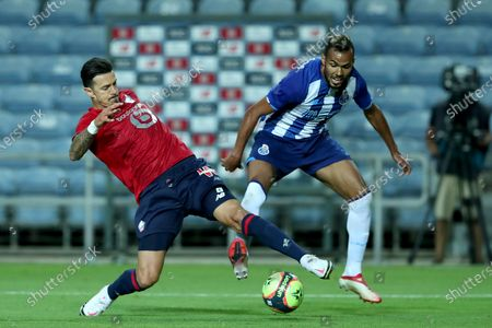 Jose Fonte of Lille OSC (L) vies with Fernando Andrade of FC Porto during the pre-season friendly football match between FC Porto and Lille OSC at the Algarve stadium in Loule, Portugal on July 25, 2021.