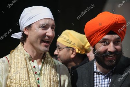 Federal Liberal opposition leader Justin Trudeau watches the colourful procession during the Khalsa Day Parade in Toronto, Ontario, Canada, on April 27, 2014. Close to a hundred thousand Sikhs filled the streets of downtown Toronto to take part in the Khalsa Day Parade to celebrate Vaisakhi and the 315th anniversary of the Khalsa.