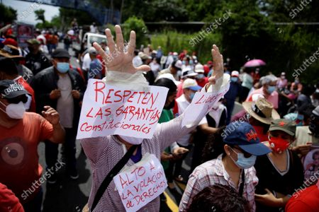 Supporters of the Farabundo Marti Front for National Liberation demonstrate in a courthouse, in San Salvador, El Salvador, 25 July 2021. The Attorney General's Office (FGR) of El Salvador presented this Sunday corruption charges against former President Salvador Sanchez Ceren (2014-2019) and nine other former officials before a court for allegedly receiving irregular payments in the administration of Mauricio Funes (2009- 2014).