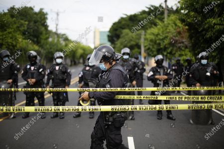 Agents of the Unit for the Maintenance of Order (UMO) stand guard in a judicial headquarters, in San Salvador, El Salvador, 25 July 2021. The Attorney General's Office (FGR) of El Salvador presented this Sunday corruption charges against former President Salvador Sanchez Ceren (2014-2019) and nine other former officials before a court for allegedly receiving irregular payments in the administration of Mauricio Funes (2009- 2014).