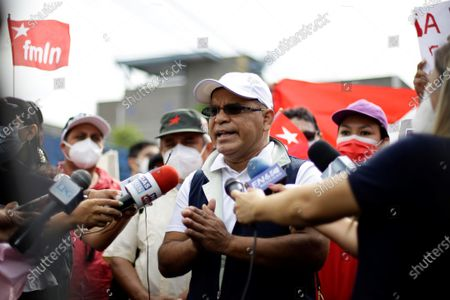 Stock Picture of The secretary general of the Farabundo Marti National Liberation Front party, Oscar Ortiz, speaks to the media outside a judicial headquarters, in San Salvador, El Salvador, 25 July 2021. The Attorney General's Office (FGR) of El Salvador presented this Sunday corruption charges against former President Salvador Sanchez Ceren (2014-2019) and nine other former officials before a court for allegedly receiving irregular payments in the administration of Mauricio Funes (2009- 2014).