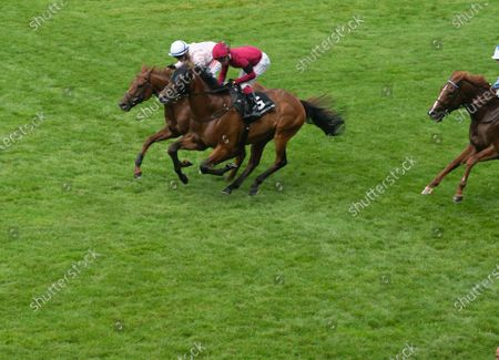 Stock Picture of Jockey Oisin Murphy (R) wins the Porsche Handicap Stakes at the Ascot QIPCO King George Diamond Weekend on horse Guru