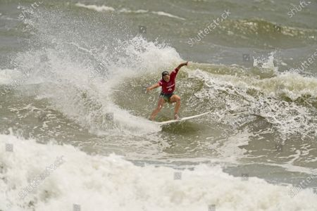 Australia's Sally Fitzgibbons maneuvers on a wave during third round of women's surfing competition at the 2020 Summer Olympics, at Tsurigasaki beach in Ichinomiya, Japan