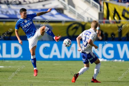 Everton FC midfielder James Rodriguez, left, jumps to get control of the ball in front of Millonarios FC defender Andres Llinas during the first half of a Florida Cup soccer match, in Orlando, Fla