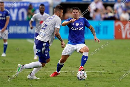 Stock Image of Everton FC midfielder James Rodriguez, right, makes a move to get around Millonarios FC defender Juan Pablo Vargaas, left, during the first half of a Florida Cup soccer match, in Orlando, Fla