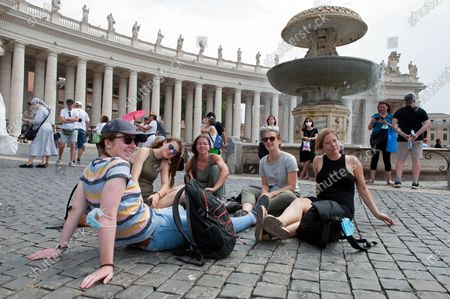 Faithfuls wait on St.Peter's Square for Pope Francis to deliver the Sunday Angelus prayer from the window of his study at the Vatican