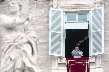 Pope Francis delivers the Sunday Angelus prayer from the window of his study overlooking St.Peter's Square at the Vatican