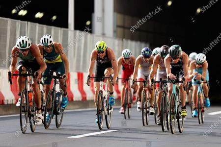 Joao Pereira, of Portugal, Russian athlete Dmitry Polyanskiy, Javier Gomez Noya, of Spain, and Jonathan Brownlee, of Britain, compete during the bike leg of the men's individual triathlon at the 2020 Summer Olympics, in Tokyo, Japan