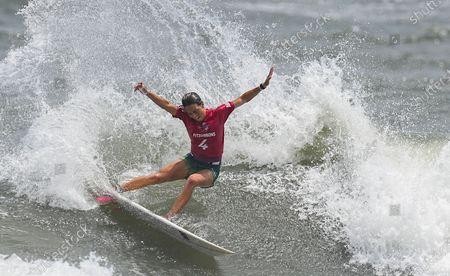 Sally Fitzgibbons from Australia surfs during the Women's Round 3 of the Surfing events of the Tokyo 2020 Olympic Games at the Tsurigasaki Surfing Beach in Ichinomiya, Japan, 26 July 2021.