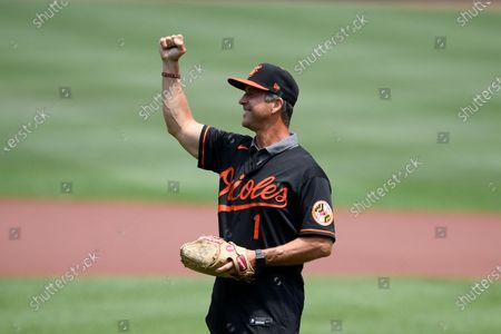 Baltimore Ravens head football coach John Harbaugh reacts before he threw out the ceremonial first pitch using a football before a baseball game between the Baltimore Orioles and the Washington Nationals, in Baltimore