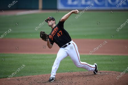 Baltimore Orioles starting pitcher John Means delivers a pitch during a baseball game against the Washington Nationals, in Baltimore