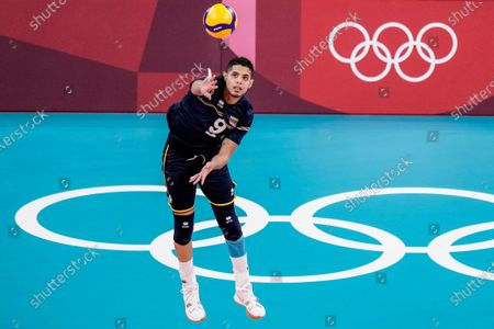 Venezuela's Jose Manuel Carrasco Angulo serves a ball during the men's volleyball preliminary round pool A match between Iran and Venezuela at the 2020 Summer Olympics, in Tokyo, Japan