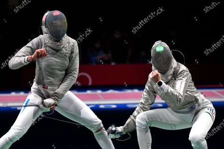 Anna Marton (R) of Hungary and Maria Balen Perez Maurice of Argentina compete during their bout in the round of 32 of women's sabre fencing of the Tokyo 2020 Olympic Games in Makuhari Messe Hall in Chiba, Japan, 26 July 2021.