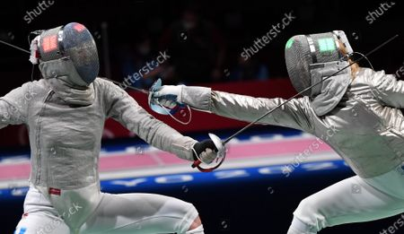 Anna Marton (R) of Hungary and Maria Balen Perez Maurice (L) of Argentina compete during their bout in the round of 32 of women's sabre fencing of the Tokyo 2020 Olympic Games in Makuhari Messe Hall in Chiba, Japan, 26 July 2021.