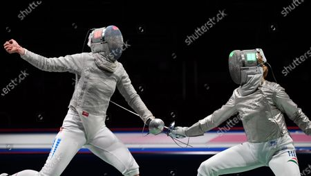 Stock Photo of Anna Marton (R) of Hungary and Maria Balen Perez Maurice (L) of Argentina compete during their bout in the round of 32 of women's sabre fencing of the Tokyo 2020 Olympic Games in Makuhari Messe Hall in Chiba, Japan, 26 July 2021.