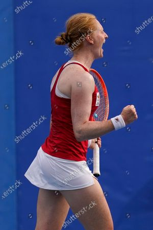Stock Picture of Alison van Uytvanck, of Belgium, reacts after defeating Petra Kvitova, of the Czech Republic, during the second round of the tennis competition at the 2020 Summer Olympics, in Tokyo, Japan