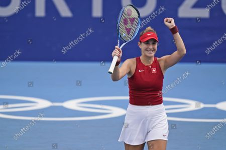 Belinda Bencic, of Switzerland, reacts after defeating Misaki Doi, of Japan, during the second round of the tennis competition at the 2020 Summer Olympics, in Tokyo, Japan