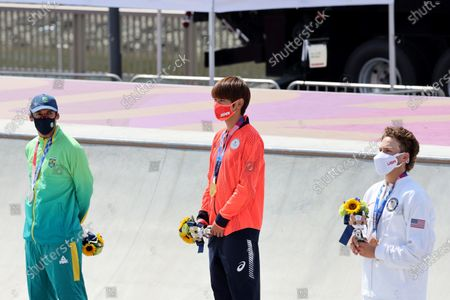 Gold medalist Japan's Yuto Horigome (C), silver medalist Brazil's Kelvin Hoefler (L) and bronze medalist United States' Jagger Eaton pose with their medals during the Tokyo 2020 Olympic Games Skateboarding Men's Street Medal Ceremony at Ariake Sports Park in Tokyo, Japan.