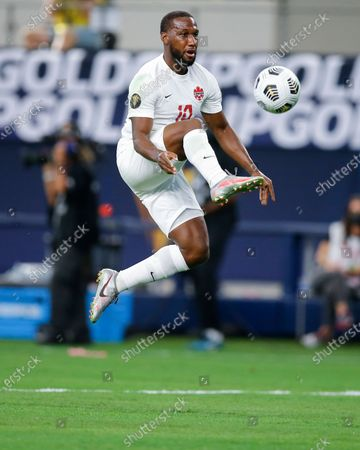 Canada forward Junior Hoilett (10) shoots the ball over Costa Rica goalkeeper Esteban Alvarado's head, not pictured, to score a goal during a CONCACAF Gold Cup Quarterfinals soccer match, in Arlington, Texas. Canada won 2-0