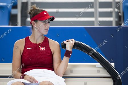 Belinda Bencic of Switzerland enjoys cool air out of a tube during her second round match against Misaki Doi of Japan in the women's single tennis competition at the 2020 Tokyo Summer Olympics at the Ariake Tennis Park in Tokyo, Japan, 26 July 2021.