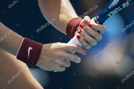 Stock Photo of A view of a Swiss cross on a fingernail of Switzerland's Belinda Bencic during her second round match against Misaki Doi of Japan in the women's single tennis competition at the 2020 Tokyo Summer Olympics at the Ariake Tennis Park in Tokyo, Japan, 26 July 2021.